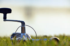 Fishing Pole on Grass. Fishing Pole lying on the grass Stock Photo