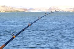 Fishing Pole with Maryhill Bridge in Background. Royalty Free Stock Photography