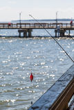 Fishing Pole off Wood Pier Royalty Free Stock Photography