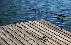 Fishing pole on pier Stock Image