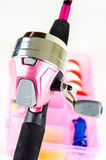 Fishing pole and tackle in Pink Stock Images