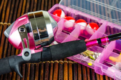 Fishing pole and tackle in Pink Royalty Free Stock Image