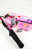 Fishing pole and tackle in Pink Stock Photography