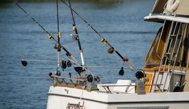 Fishing poles and boat Stock Images