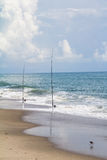 Fishing poles on the beach Stock Photos