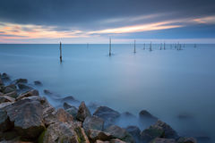 A Dutch lake, Markermeer during Sunset, with a long exposure. Laker Markermeer with a long exposure during Sunset Stock Photo
