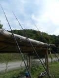 Fishing poles leaning on shack Stock Photos