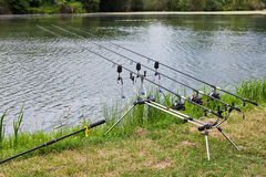 Fishing poles mounted on the holder Royalty Free Stock Photo