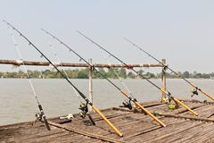 Fishing Poles on Pier Stock Photos