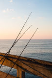 Fishing Poles on Pier Royalty Free Stock Images