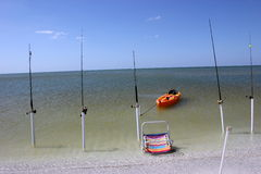 Fishing poles seaside Stock Photos