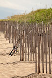 Fishing Poles on Snow Fence Royalty Free Stock Photo