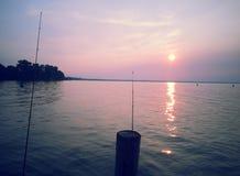 Fishing Poles Sunrise Stock Photography