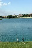Fishing poles by water Royalty Free Stock Photo