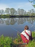 Fishing on pond 2 Royalty Free Stock Photography