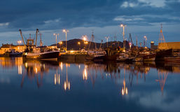 A Fishing port. Fishing boats at small fishing port in Ireland at dusk stock images