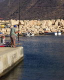 Fishing at the port Royalty Free Stock Photography