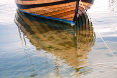 Fishing port. Fishing boat in port against blue water royalty free stock photos