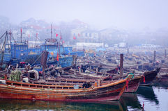 Fishing port. Chinese fishing ships in the morning fog Royalty Free Stock Photography