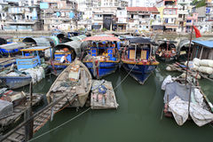 Fishing port. In amoy city,china.hard to believe that the fish we usually eat is salvaged by so dilapidated boats stock image