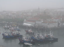 The fishing port of Bermeo under the fog Stock Image