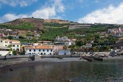 Fishing port of Camara de Lobos, Madeira, Portugal. Fishing port of Camara de Lobos, on the south east coast of Madeira, Portugal, showing harbor, typical houses Stock Photography