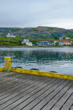 Fishing port and the church in Holmavik. View of the town, fishing port and the church in Holmavik, the west fjords region, Iceland Royalty Free Stock Photography