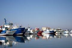 Fishing port of Kelibia. Colorful fishing trawlers in fishing port of Kelibia. Tunisia. Mediterranean sea stock photos