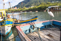 Fishing port. Peruibe, SP, Brazil, May 11, 2009. Boats and egret in the fishing port of the mouth of Rio Preto, in Peruíbe stock photos