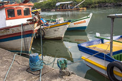 Fishing port. Peruibe, SP, Brazil, May 11, 2009. Boats and fishermen in the fishing port of the mouth of Rio Preto, in Peruíbe stock image