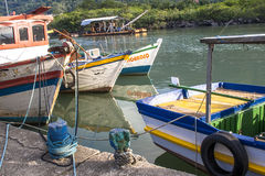 Fishing port. Peruibe, SP, Brazil, May 11, 2009. Boats and fishermen in the fishing port of the mouth of Rio Preto, in Peruíbe stock photography