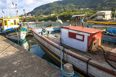 Fishing port. Peruibe, SP, Brazil, May 11, 2009. Boats and fishermen in the fishing port of the mouth of Rio Preto, in Peruíbe royalty free stock photography