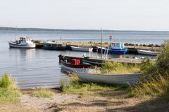 Fishing port with small boots. Several small ships at a landing Stock Image