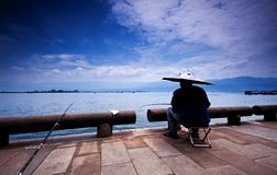 Fishing in Qionghai Lake. Qionghai is the second largest fresh water lake in Sichuan Province, 7 km from the city center, at the northern foot of Shandong Wo Yu royalty free stock photo