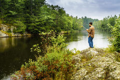 Fishing in the rain Royalty Free Stock Photography