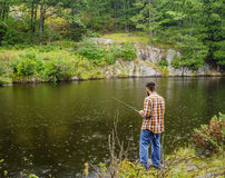 Fishing in the rain Royalty Free Stock Photo