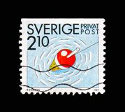 Fishing, Rebate stamps - Summer Activities serie, circa 1989. MOSCOW, RUSSIA - AUGUST 18, 2018: A stamp printed in Sweden shows Fishing, Rebate stamps - Summer stock photography