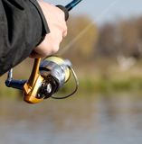 Fishing reel. The fisherman with a fishing reel Stock Images
