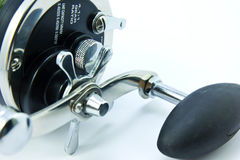 Fishing reel. On white back ground Royalty Free Stock Image