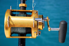 Fishing Reel. Sport fishing reel ready to go to catch the big ones Royalty Free Stock Images