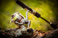 Fishing reel. Blur natural background Stock Images