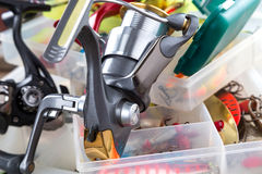 Fishing reel on boxes with lures and wobblers Stock Photography