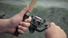 Fishing reel closeup slow motion stock video footage