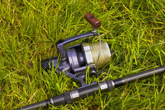 Fishing reel on the grass Stock Images