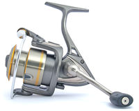 Fishing reel grey with gold stock images