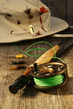Fishing reel and hat Royalty Free Stock Images