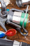 Fishing reel with line on background Stock Images