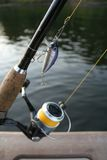 Fishing reel with a lure Stock Image