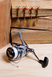 Fishing reel with metal lures. Royalty Free Stock Image