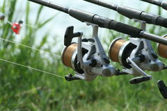Fishing reel on the river bank Royalty Free Stock Photos